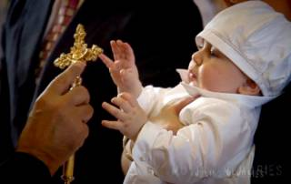 Catholic Christening of a Baby Boy being Blessed by the Priest