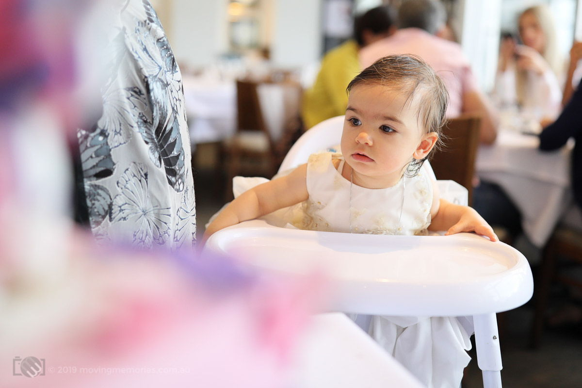 baby girl in high chair at Sydney Christening reception Moving Memories Australia