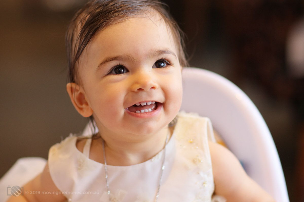 baby Marie smiling at her Christening reception at Bayblu Seafood Restaurant Blakehurst south of Sydney