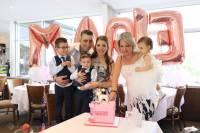 cutting the unicorn pink cake at baby Marie's Christening at Bayblu Seafood Restaurant Blakehurst south of Sydney