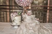 baby girl Valantia with her cake, balloon dressed in her Christening gown the Canterbury Leagues Club Sydney to celebrate her Greek Orthodox Christening