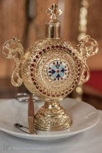 an ornate vessel and the scissors that the priest will use to cut a lock of hair from the baby in a Sydney Greek Orthodox Christening service