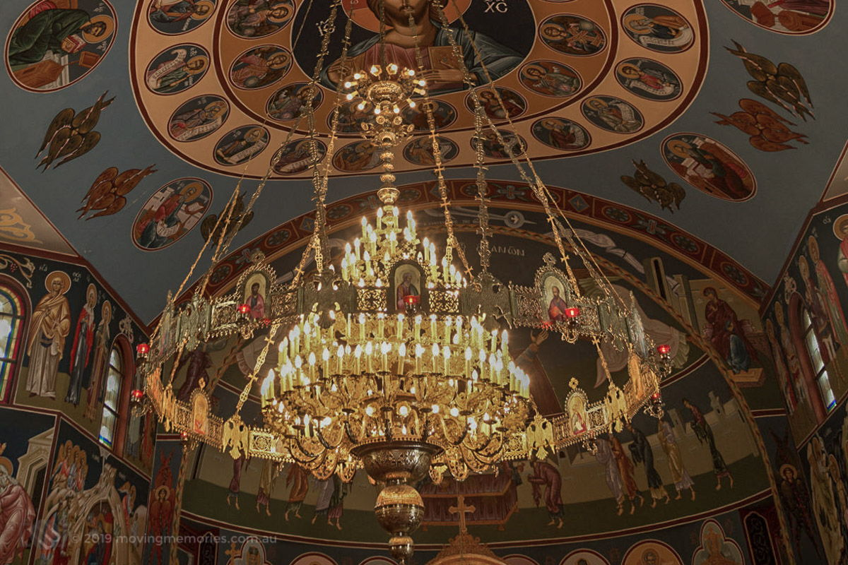 the very ornate chandelier, paintings of Saints and icons that adorn the ceiling of a Sydney Greek Orthodox Church at St. Catherine's Mascot