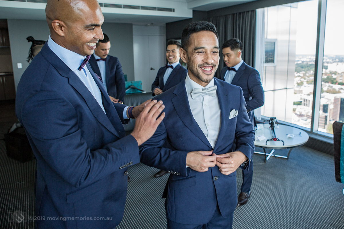 Sydney Groom Ermel getting a bit of attention from his best man before his wedding at the Lakes Sydney