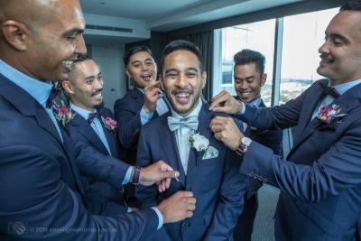Sydney Groom Ermel getting a bit of attention from his groom's men before his wedding at the Lakes Sydney
