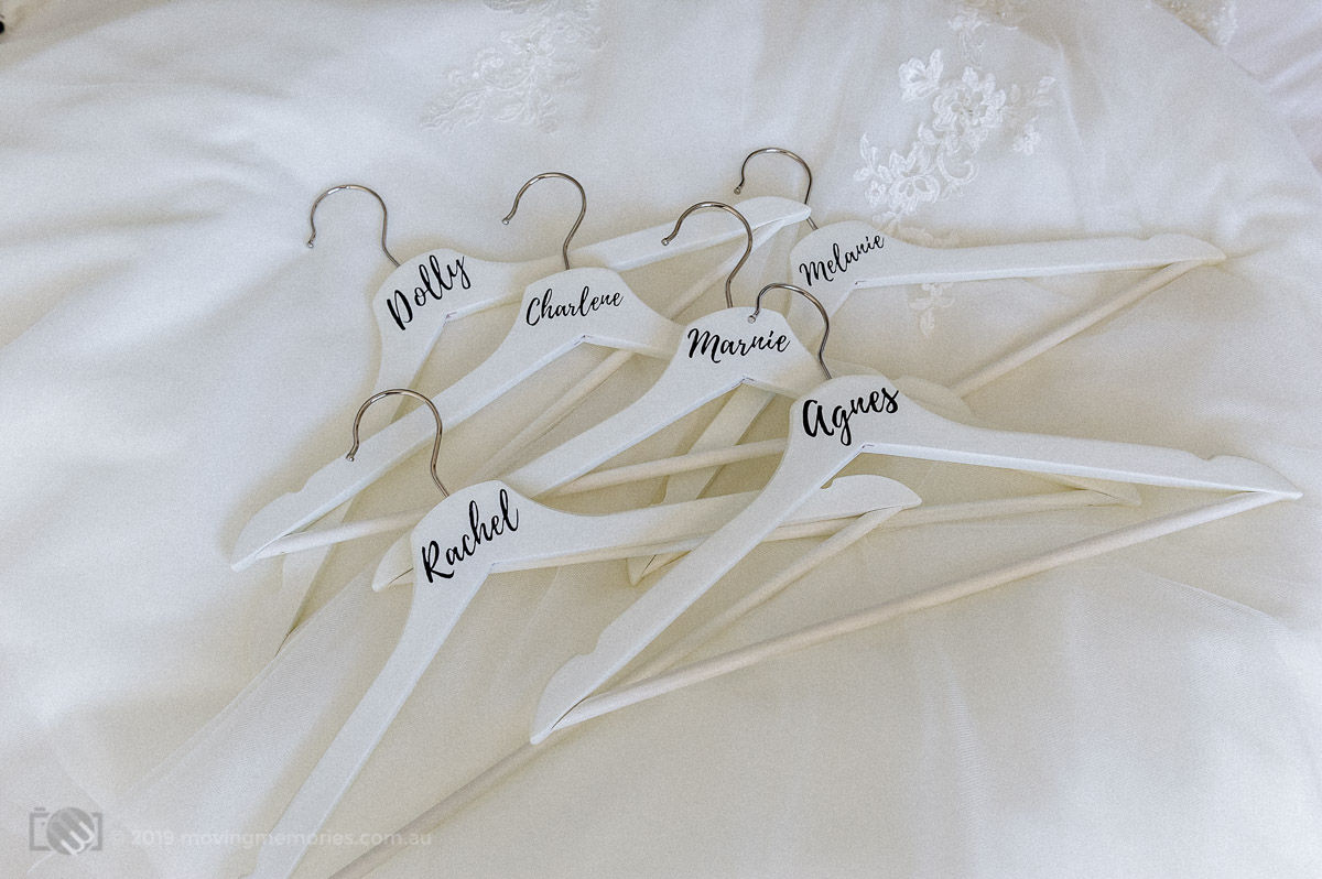 The hangers of the bride and her bide's maids decorated with their names
