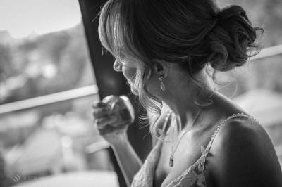 Sydney Bride Rachel spraying perfume as she prepared with her bride's maids for her wedding ceremony at the Lakes Sydney