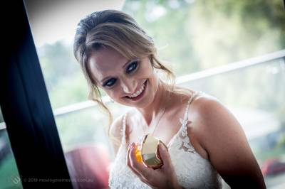 Sydney Bride Rachel poses for a shot with her perfume as she prepared with her bride's maids for her wedding ceremony at the Lakes Sydney