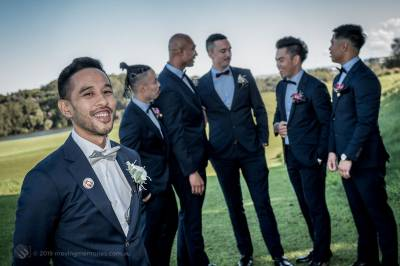 Sydney Groom Ermel, posing for a shot with his groom's men in the background just before his bride arrives at the Lakes Sydney