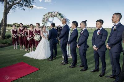 Sydney Groom Ermel, with his Bride Rachel, holding hands and exchanging vows surrounded by their bridal party and witnesses at their nuptials on the golf course at the Lakes Sydney