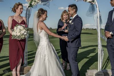 Sydney Groom Ermel, with his Bride Rachel, holding hands at their nuptials on the golf course at the Lakes Sydney