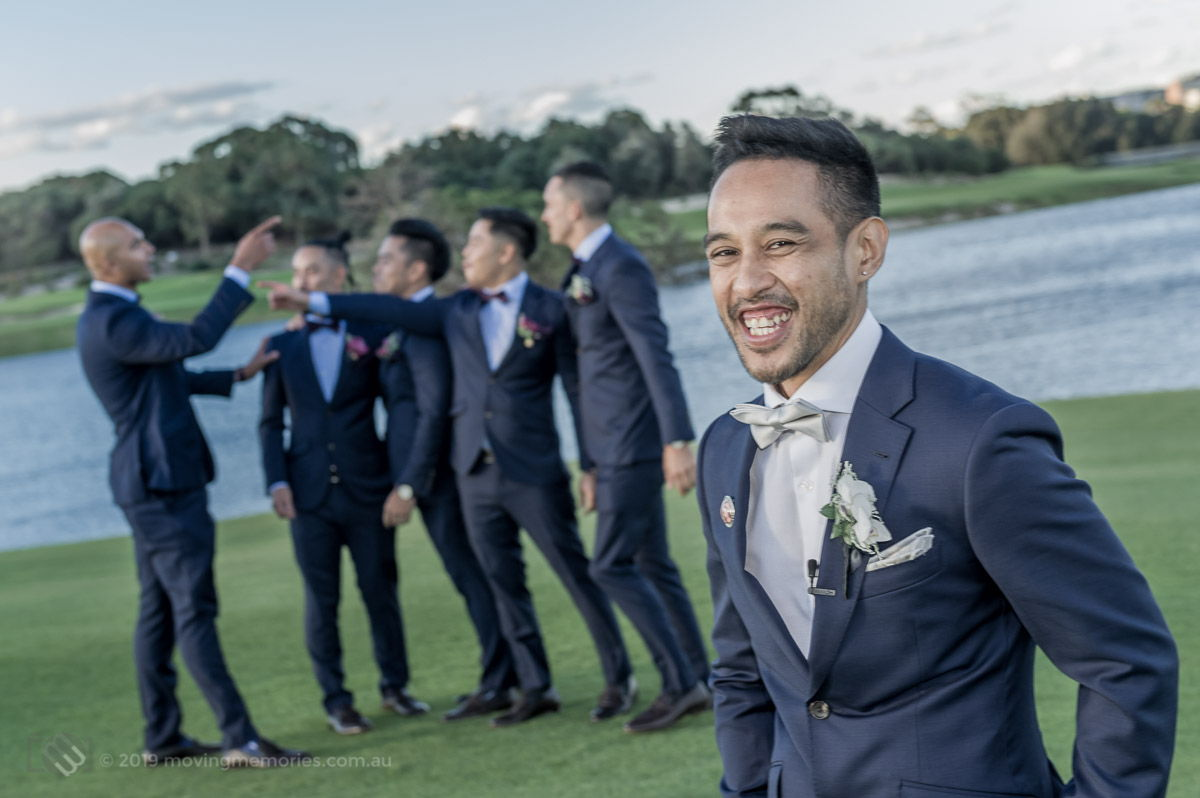 Sydney Groom, Ermel, posing for a shot with his groomsmen in the background by the lake at the Lakes Sydney