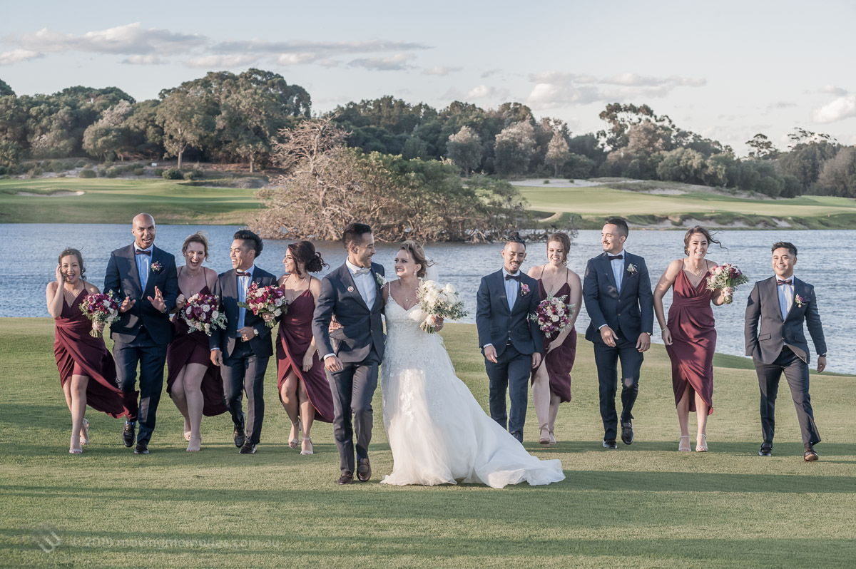Sydney Bride and Groom walk with their bridal party on the golf course by the lake at the Lakes Sydney