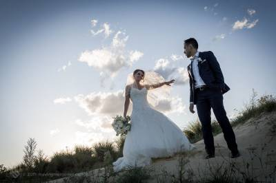 Sydney Bride and Groom stand on the sand dunes at the Lakes Sydney