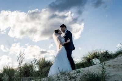 Sydney Bride and Groom embrace on the sand dunes at the Lakes Sydney