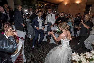Sydney Bride and Groom dance surrounded by their guests shortly after entering their Wedding reception at the Lakes Sydney