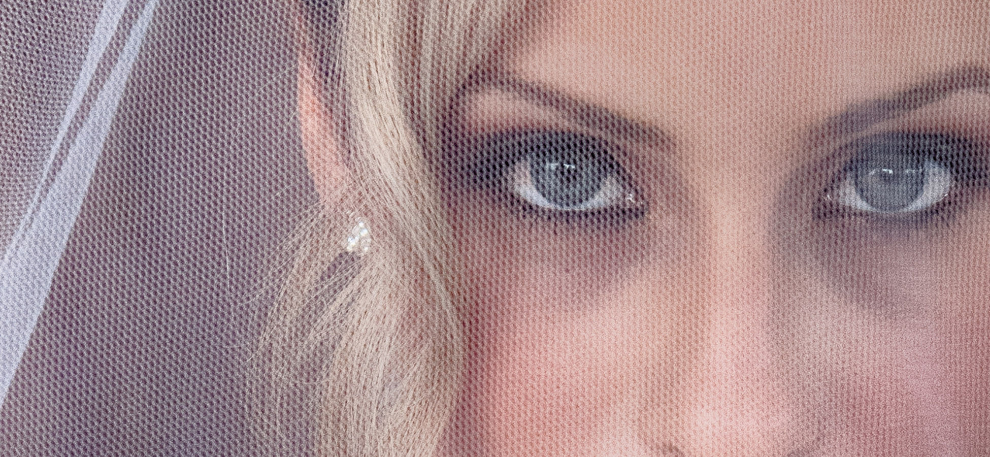 Sydney-Wedding-Video-&-Photography-of-a-beautiful-Sydney-bride-close-up-with-blue-eyes-gaze-from-under-her-veil