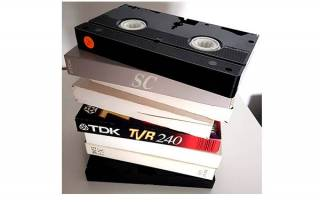 VHS tapes stack with underside of VHS tape shown