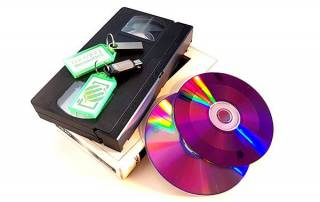 VHS tapes with USB memory sticks and DVD discs