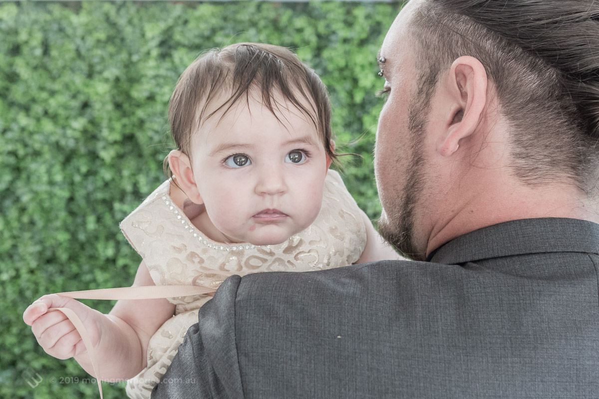 the-baby-held-by-her-father-at-home-preparing-for-Baby-Girl-Andrjea-Christening-at-Macedonian-Orthodox-Church-Wollongong-Panorama-House