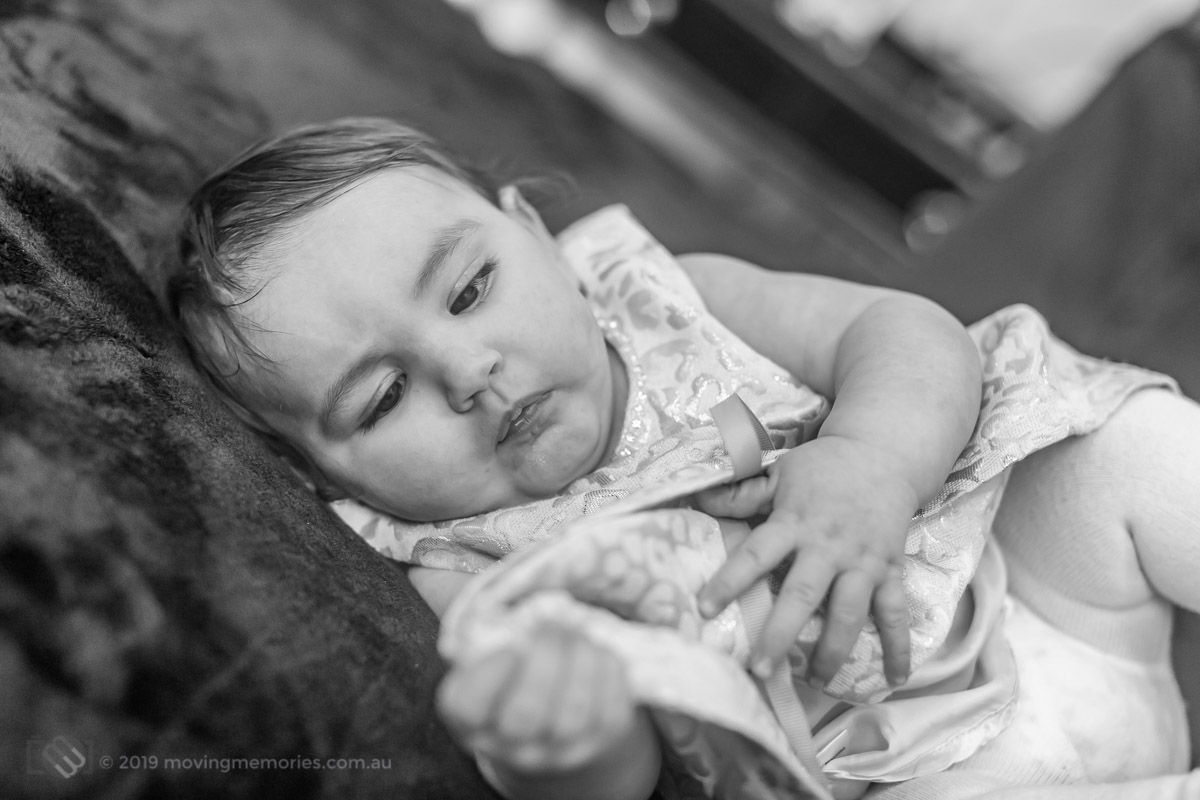 black-and-white-shot-as-they-prepare-at-home-for-Baby-Girl-Andrjea-Christening-at-Macedonian-Orthodox-Church-Wollongong-Panorama-House