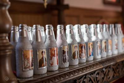 decorative-bottles-of-holy-water-placed-at-the-altar-before-the-ceremony-for-Baby-Girl-Andrjea-Christening-at-Macedonian-Orthodox-Church-Wollongong-Panorama-House