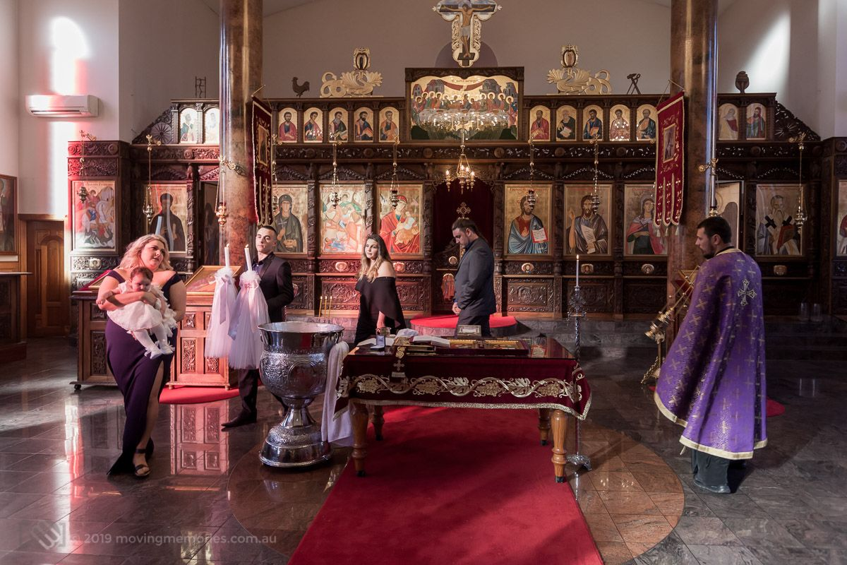 a-wide-shot-of-the-priest-baby-God-parents-and-parents-circle-at-the-altar-for-Baby-Girl-Andrea-Christening-at-Macedonian-Orthodox-Church-Wollongong