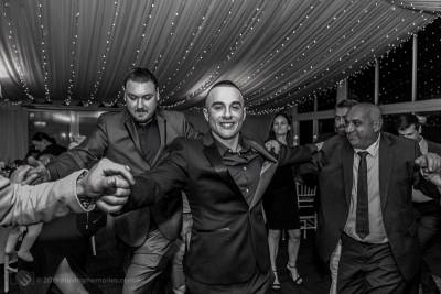 the-God-father-joined-by-the-father-and-other-guests-dancing-at-the-reception-for-Baby-Girl-Andrea-Christening-at-Panorama-House-Bulli-Tops-near-Wollongong