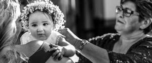 sydney-christening-video-and-photography-captures-a-baby-just-after-baptism-embrace-by-her-Godmother-and-grandmother