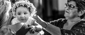 sydney-christening-video-and-photography-captures-a-baby-just-after-baptism-embrace-by-her-Godmother-and-grandmother-800px