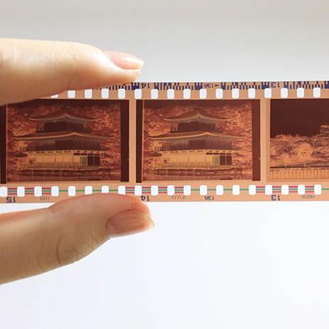 square-social-0002-person-holding-camera-film-2061678-min