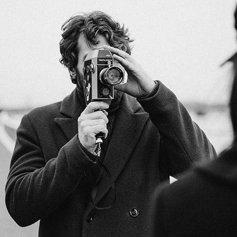 square-social-0007-gray-scale-photo-of-man-holding-analog-camera-3692621-min
